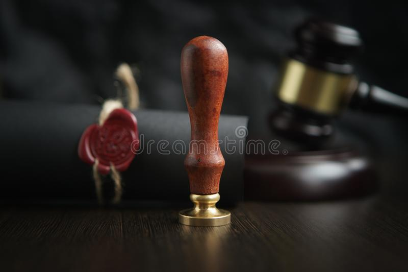 Law, attorney, notary public stamp and pen on desk. law will notary paper lawyer fountain pen seal concept royalty free stock photography