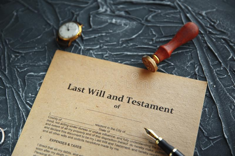 Notary`s public pen and stamp on testament and last will. Notary public. Tools royalty free stock images