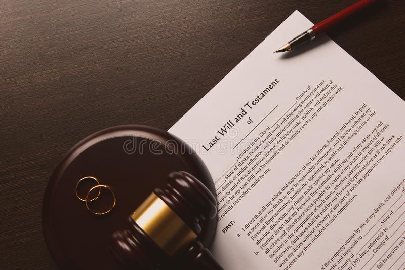 Notary`s public pen and stamp on testament and last will. Concept stock photography