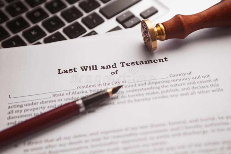 Notary`s public pen and stamp on testament and last will. royalty free stock photo