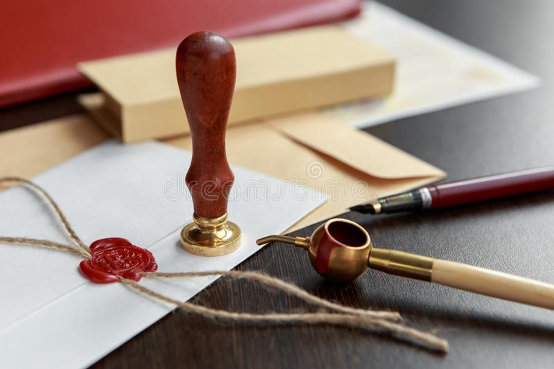 Notary`s public pen and stamp on testament and last will. Notary public tools stock photography