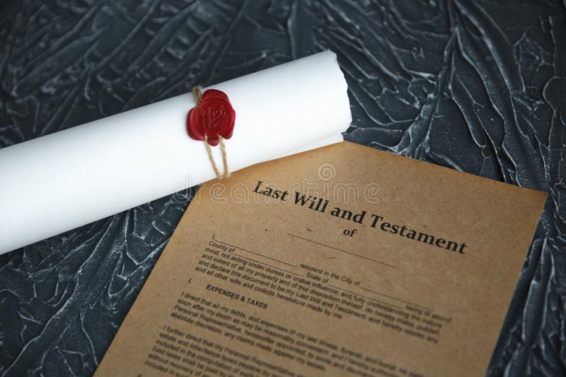 Notary`s public pen and stamp on testament and last will. Notary public. Tools stock photography