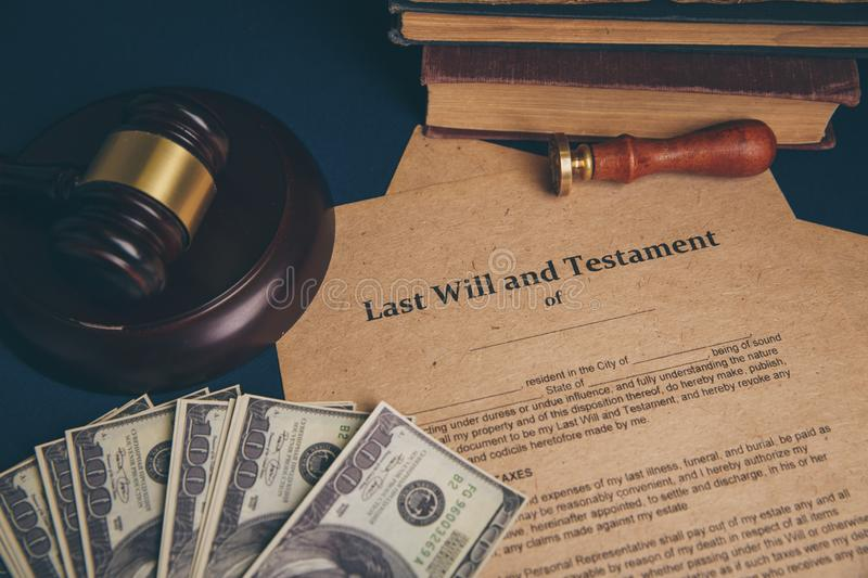 Notary`s public pen and stamp on testament and last will. Notary public. Tools royalty free stock photography