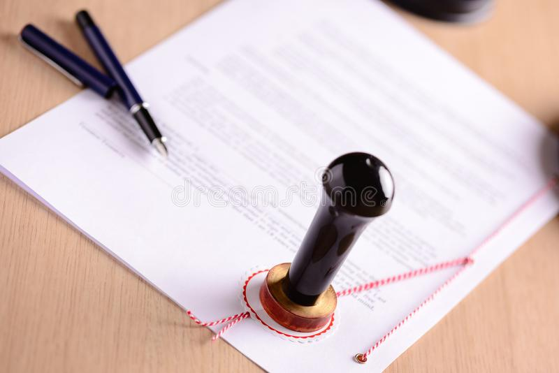 Notary's public pen and stamp on testament stock image