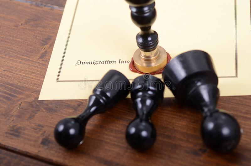 Notary seals and Immigration law on the wooden background stock photos
