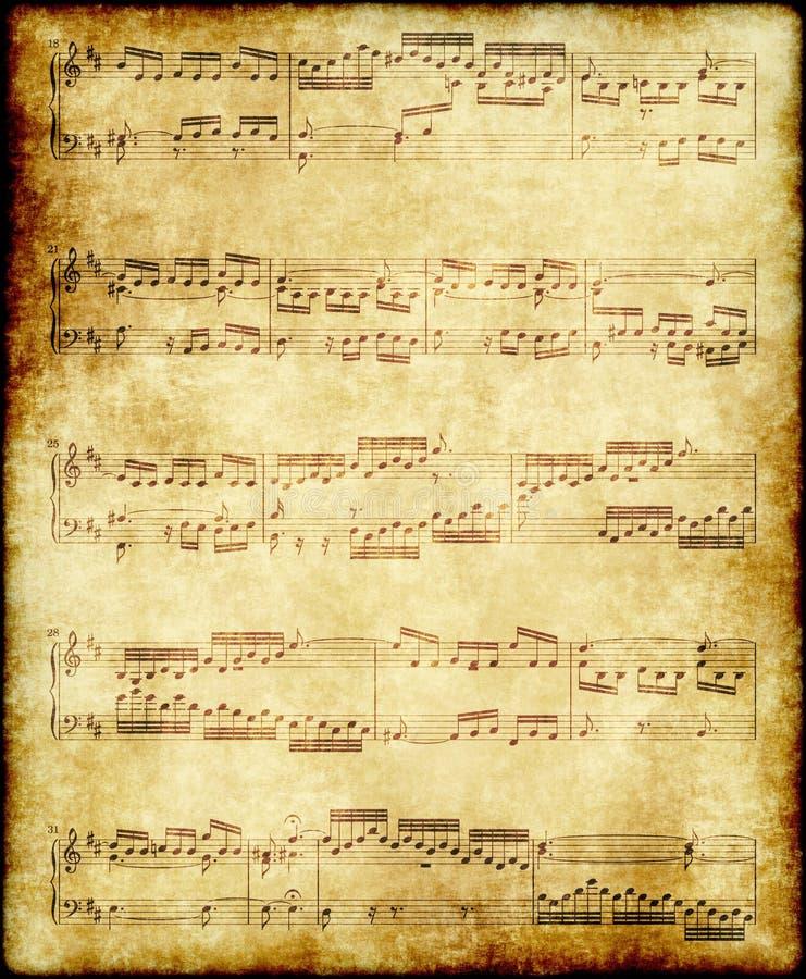 Notas da música no papel velho imagens de stock