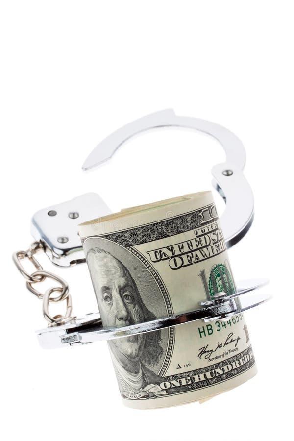 Notas da moeda do dólar com algemas imagem de stock royalty free