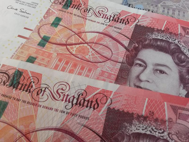 Notas de banco e moedas do GBP foto de stock royalty free