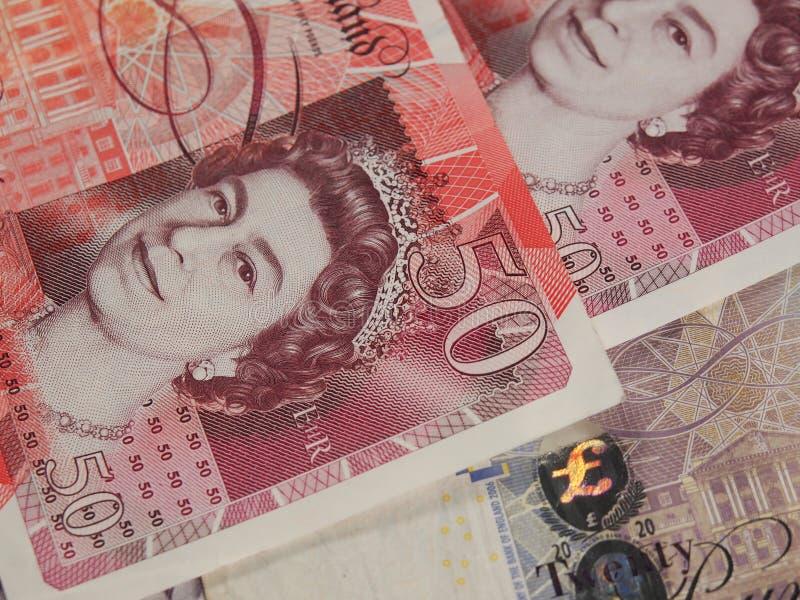 Notas de banco e moedas do GBP fotografia de stock royalty free