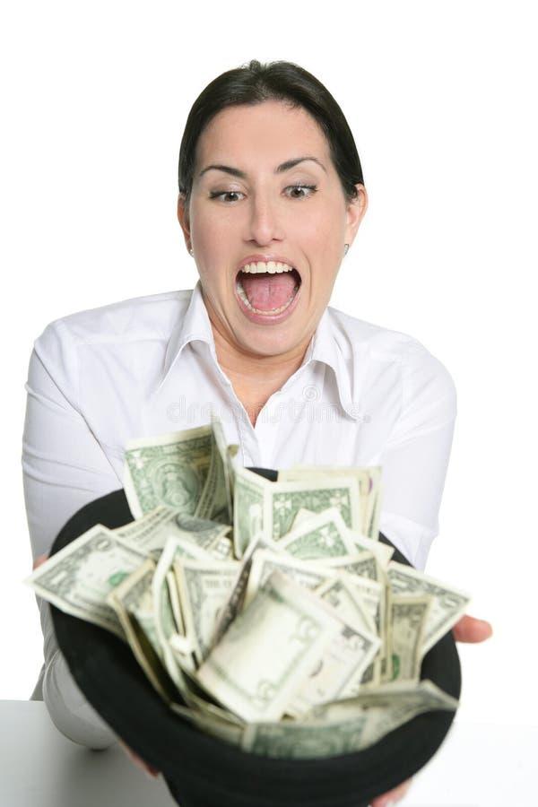 Notas del dólar en manos triguenas felices de la mujer imágenes de archivo libres de regalías
