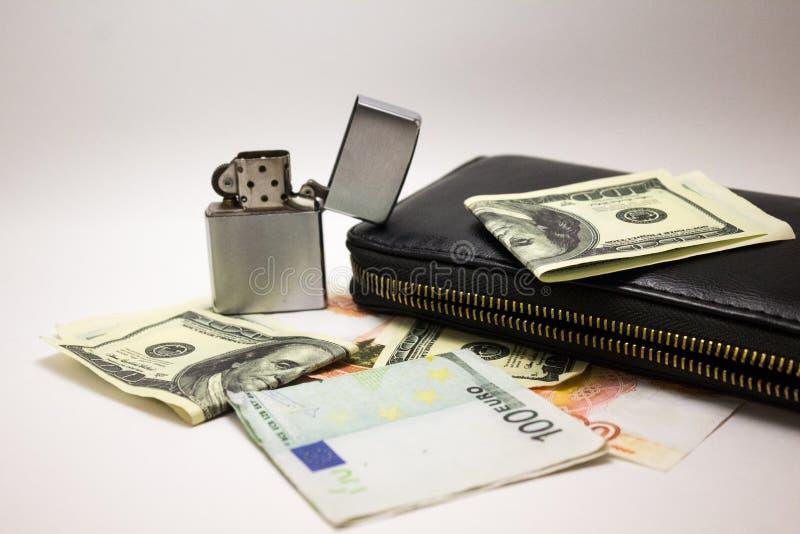 Notas del dólar y del euro sobre un fondo blanco fotografía de archivo libre de regalías