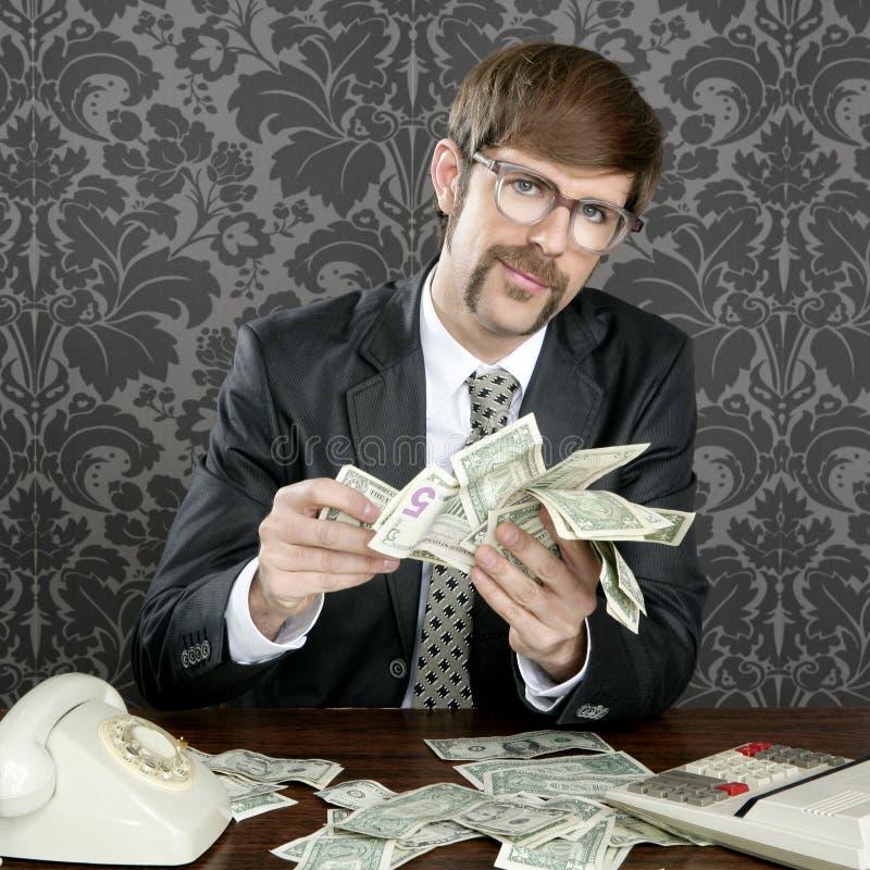 Notas do dólar do contabilista do lerdo do homem de negócios fotografia de stock
