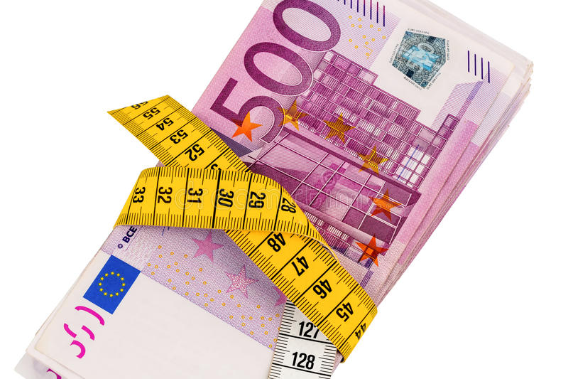 Notas e uma fita métrica imagem de stock royalty free