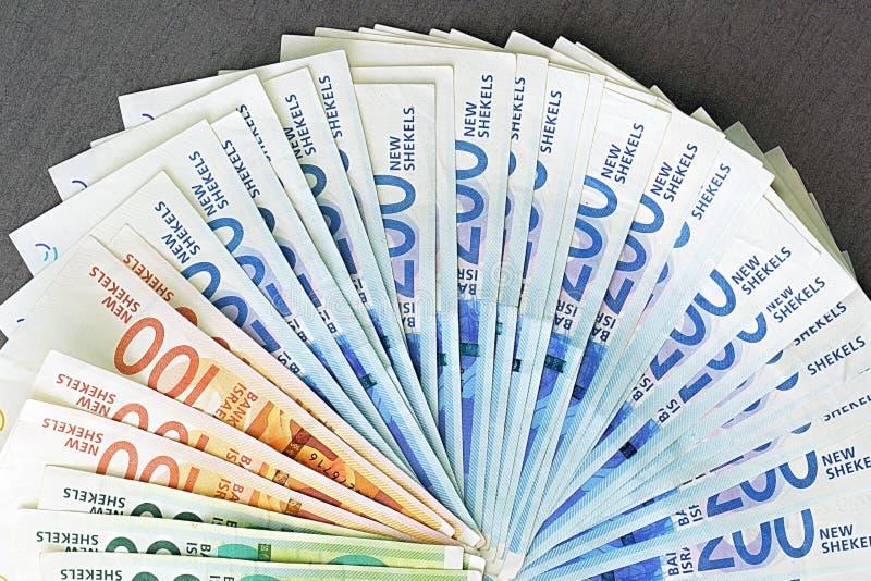 Notas israelitas do dinheiro Fã de cédulas do shekel foto de stock