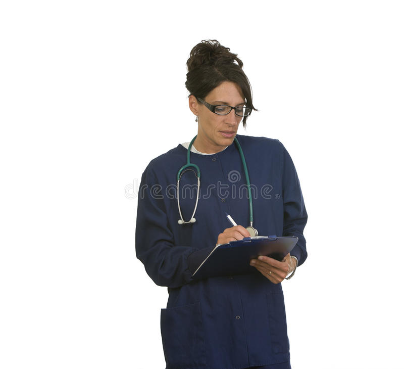 Notas médicas de la escritura de la enfermera fotos de archivo libres de regalías