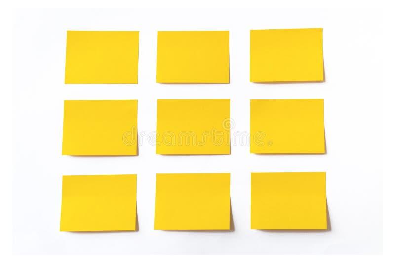 Notas pegajosas amarillas fotos de archivo