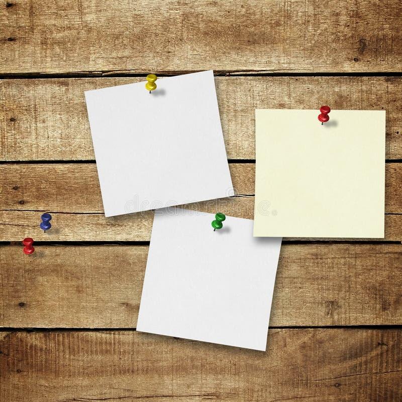 Notas sobre el fondo de madera del tablón fotografía de archivo