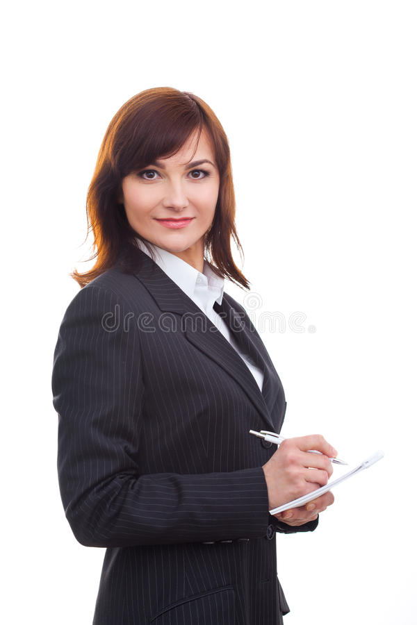 Notas superiores da escrita da mulher de negócios, sorrindo e imagens de stock