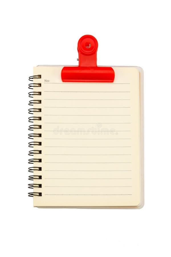 Notatnik i czerwona klamerka zdjęcie stock