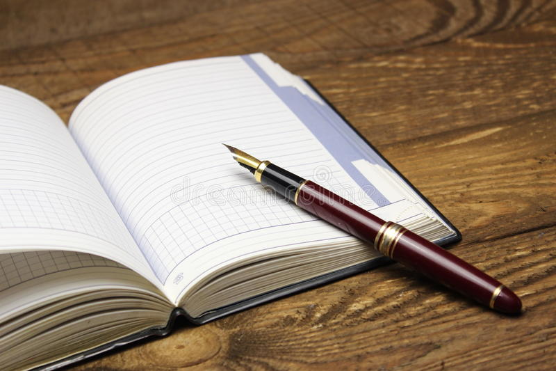 Notatnik i pióro zdjęcie royalty free