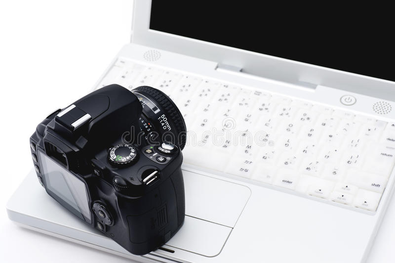 Notatnika SLR i peceta kamera fotografia stock