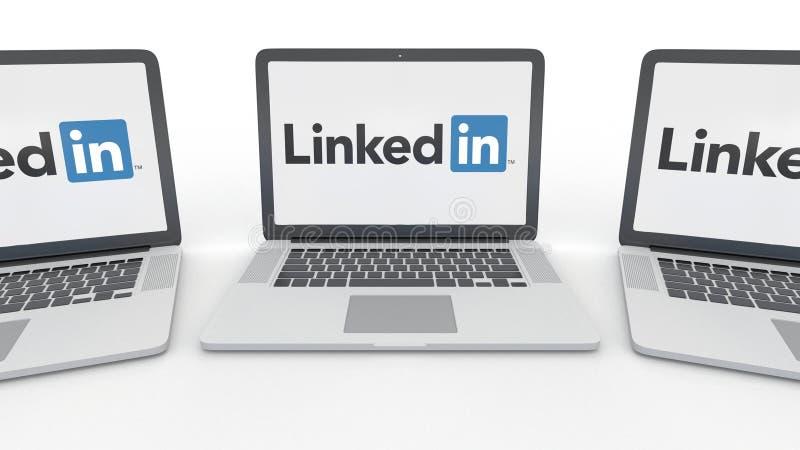 Notatniki z LinkedIn logem na ekranie Informatyka artykułu wstępnego 3D konceptualny rendering ilustracji