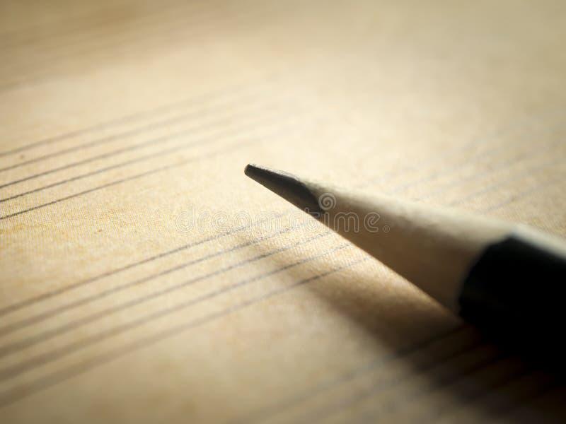Notazione di musica del foglio bianco e della matita immagine stock libera da diritti