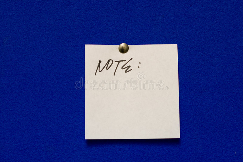 Note. Post-it note on blue background royalty free stock image