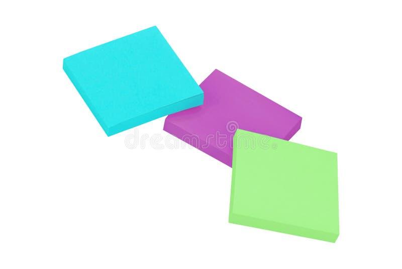 Note appiccicose colorate isolate su bianco immagini stock