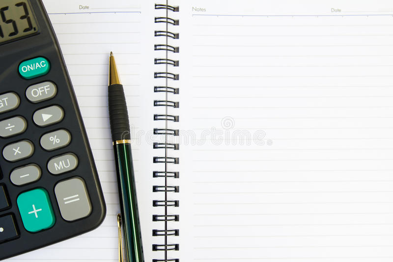 Note book with calculator and pen
