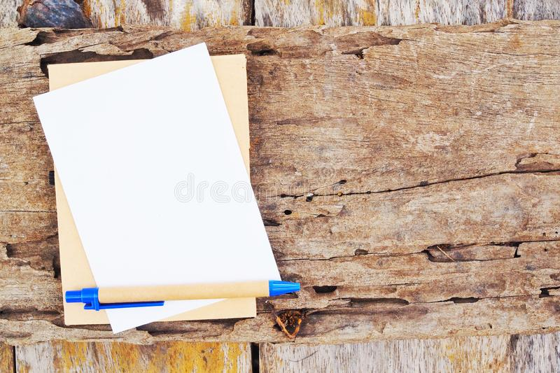 Note book and pen on wood board royalty free stock photo