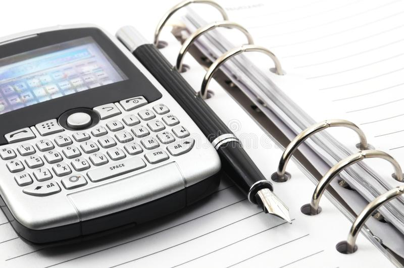 Note Book And Phone Stock Images