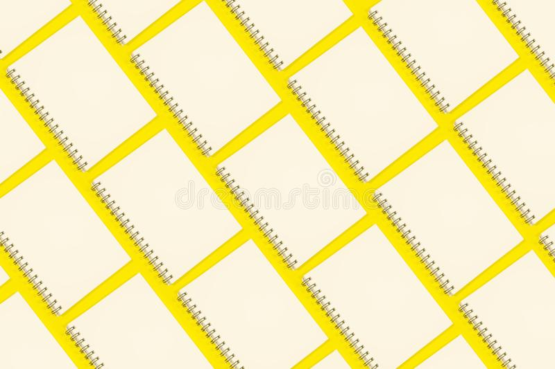 Note books. Abstract pattern on yellow background royalty free stock images