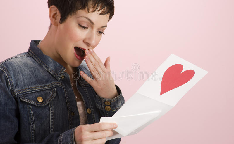 Woman Touched Receives Valenties Day Note Card royalty free stock photos