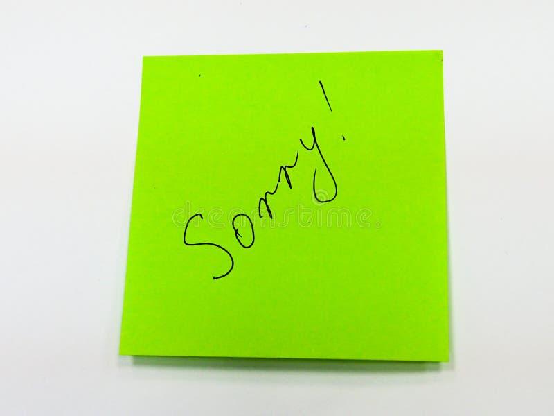 Note collante avec le texte désolé, carte de motivation photographie stock libre de droits