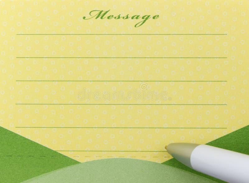 Note collante de stylo et de message photographie stock