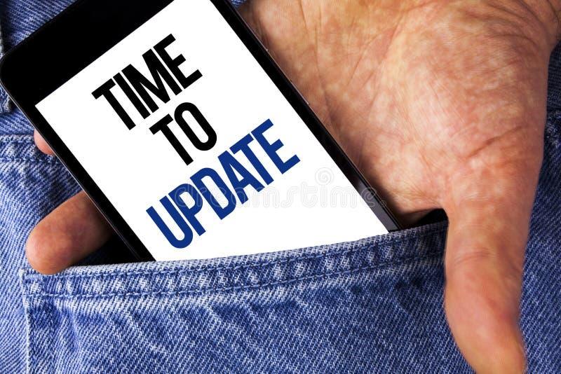 Note d'écriture montrant l'heure de mettre à jour Le renouvellement de présentation de photo d'affaires mettant à jour des change photos libres de droits
