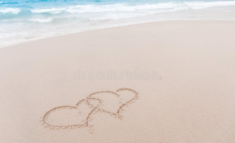Note d'amour dans le sable photographie stock