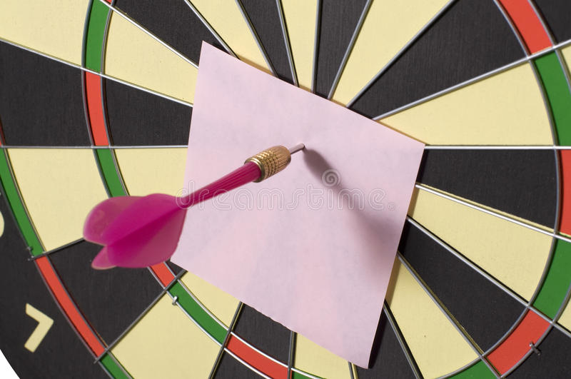 Note And Dart. Blank paper and dart board. You can put your writing here royalty free stock image