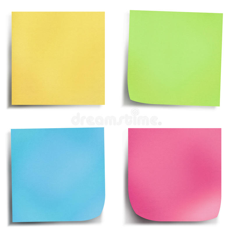 Note de post-it de quatre couleurs photographie stock libre de droits