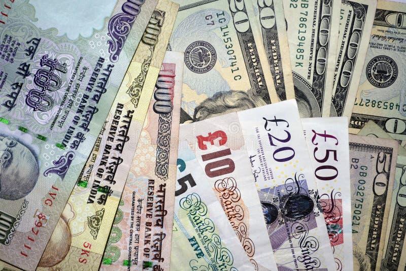 Note di valuta dell'indiano, del Regno Unito e degli Stati Uniti dei soldi fotografia stock