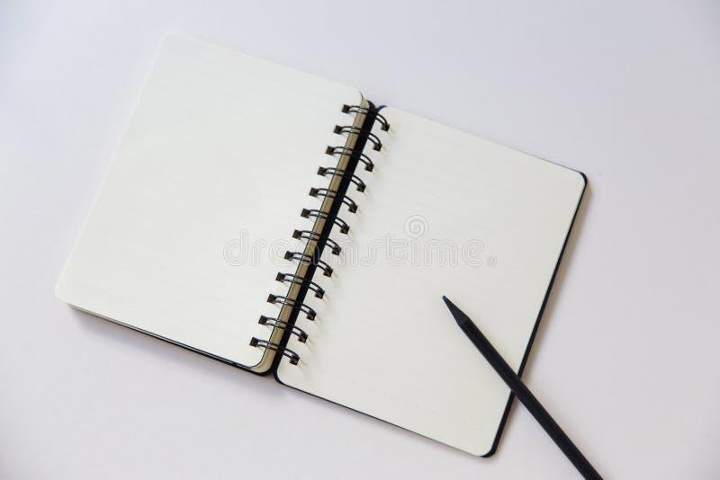 Note a escrita com espaço da cópia no fundo branco fotos de stock