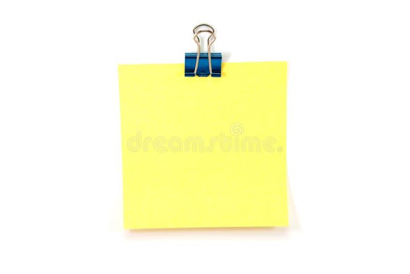 Note jaune avec un clip de cahier photo libre de droits