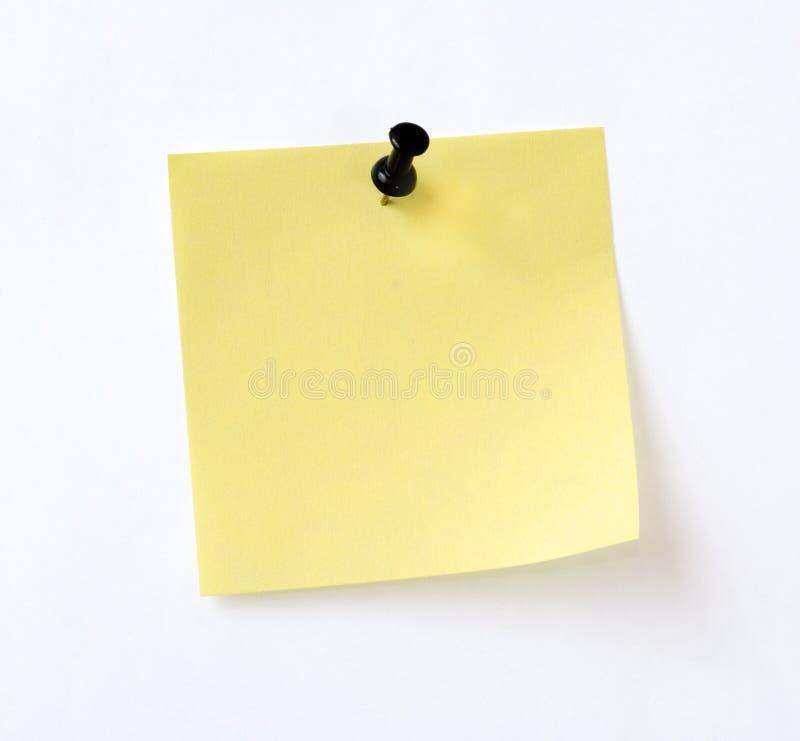 Note jaune d'isolement photos stock