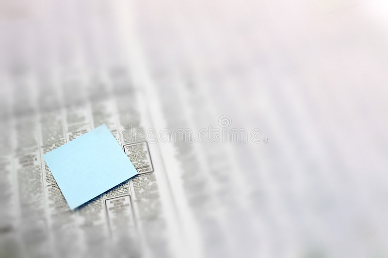 Note in newspaper royalty free stock images