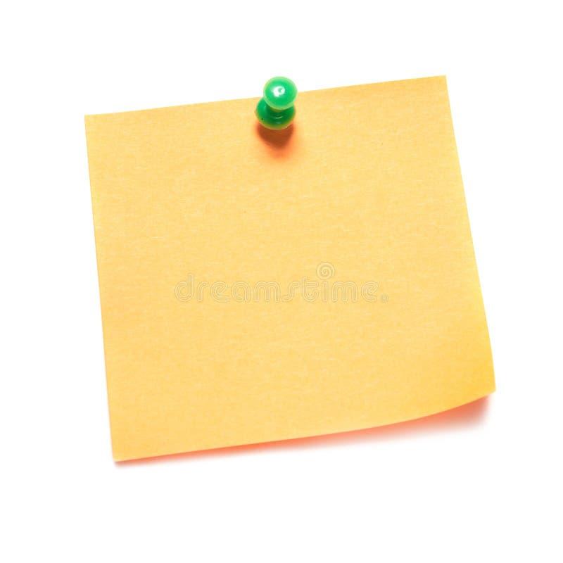 Note orange avec la pointe image stock