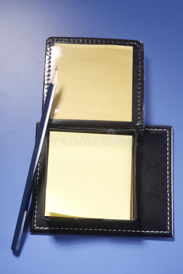 Note pad and pencil stock images