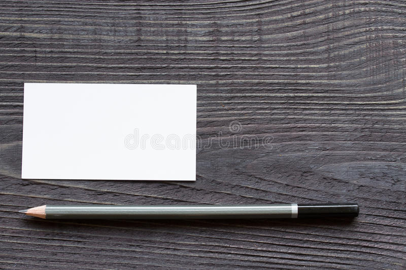 Note pad and pencil on a wooden background stock images