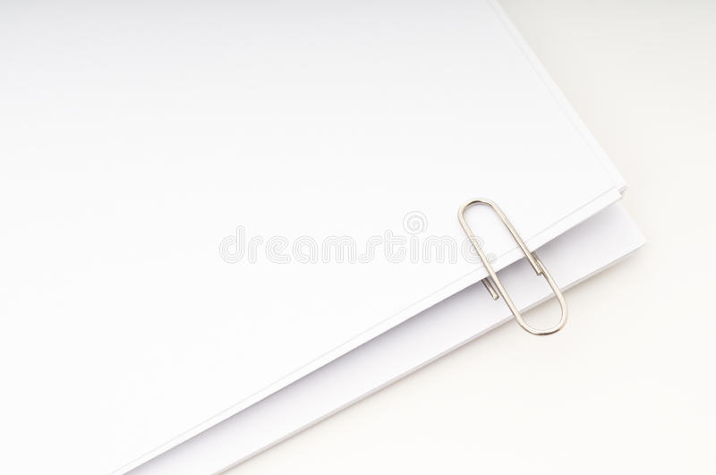 Note pages stacked with clip. Blank note pages stacked with clip isolated on white background stock photography
