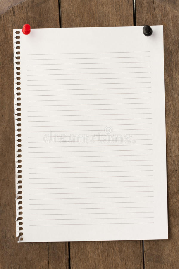 Note paper. Writing old note paper on wood background stock photography